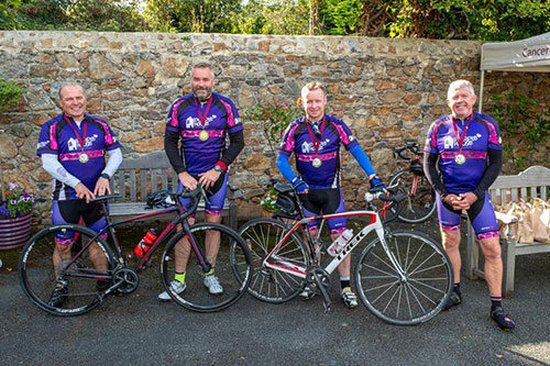 Cyclists saddle up in aid of Purple House charity
