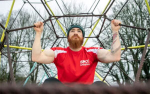 Michael Casey pulls himself up to raise support for Childline